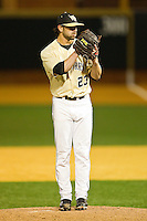 Wake Forest Demon Deacons closer Michael Dimock #23 in action against the Georgetown Hoyas at Wake Forest Baseball Park on February 26, 2012 in Winston-Salem, North Carolina.  The Demon Deacons defeated the Hoyas 5-2.  (Brian Westerholt / Four Seam Images)