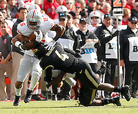 Ohio State Buckeyes running back Ezekiel Elliott (15) is tackled by Purdue Boilermakers safety Taylor Richards (4) during Saturday's NCAA Division I football game at Ross-Ade Stadium in West Lafayette, In. on November 2, 2013. (Barbara J. Perenic/The Columbus Dispatch)