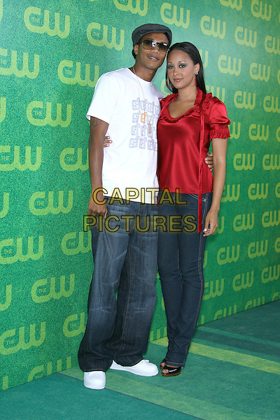 TIA MOWRY & GUEST.The CW Network July 2006 TCA - Arrivals held at Ritz Carlton Huntington Hotel, Pasadena, California, USA..July 17th, 2006.Photo: Zach Lipp/AdMedia/Capital Pictures.Ref: ZL/ADM.full length red satin top white skinny jeans.www.capitalpictures.com.sales@capitalpictures.com.© Capital Pictures.