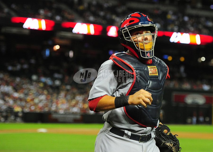 May 8, 2012; Phoenix, AZ, USA; St. Louis Cardinals catcher Yadier Molina during game against the Arizona Diamondbacks at Chase Field. Mandatory Credit: Mark J. Rebilas-