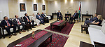 Palestinian Prime Minister, Rami Hamdallah, receives the report of the Bureau of Financial and Administrative Control for the year 2016, in the West Bank city of Ramallah, on July 17, 2017. Photo by Prime Minister Office