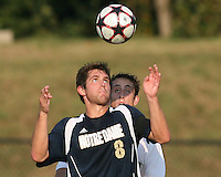 04 September 2009: Michael Thomas #8 of the University of Notre Dame shields the ball from Anthony Arena #3 of Wake Forest University during an Adidas Soccer Classic match at the University of Indiana in Bloomington, In. The game ended in a 1-1 tie..