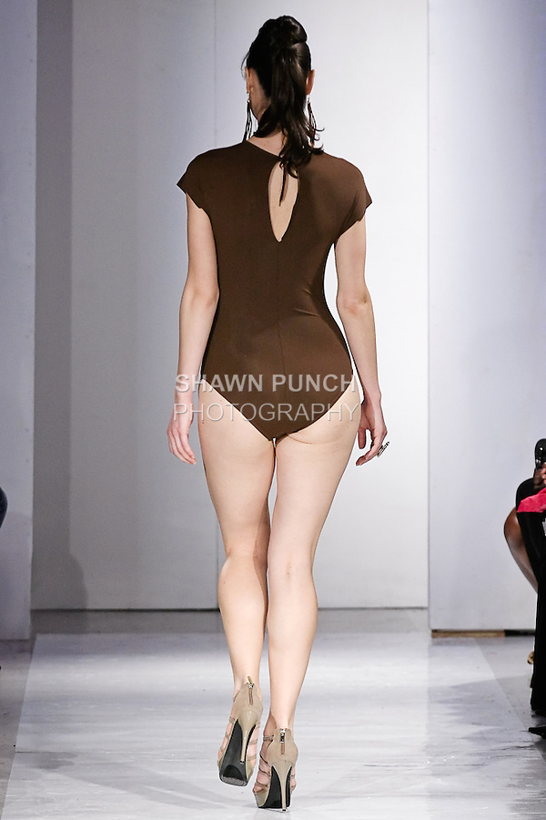 Model walks the runway in a swimsuit by Melinda Huff, from her Mirame Spring Summer 2012 Sun and Shadows collection, during BK Fashion Weekend Spring Summer 2012.