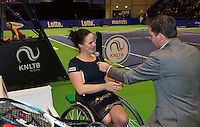 December 21, 2014, Rotterdam, Topsport Centrum, Lotto NK Tennis, Lady's wheelchair final,  Winner Aniek van Koot   being interviewed by Alex Nelissen<br /> Photo: Tennisimages/Henk Koster