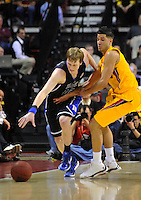 Kyle Singler of the Blue Devils tries to control the loose ball against Greivis Vasquez of the Terrapins. Maryland defeated Duke 79-72 at the Comcast Center in College Park, MD on Wednesday, March 3, 2010. Alan P. Santos/DC Sports Box