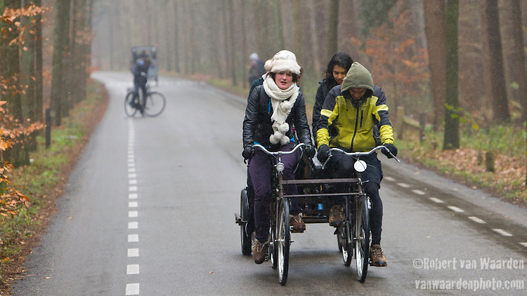 Volunteers cycle the bikes through the woods in the direction of Amsterdam.