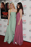 HOLLYWOOD, CA - NOVEMBER 07: Elle Fanning and Alice Englert arrive at the 'Ginger And Rosa' special screening during AFI Fest 2012 at Grauman's Chinese Theatre on November 7, 2012 in Hollywood, California.