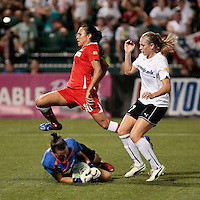Marta (10) of the Western New York Flash is stopped by magicJack goalkeeper Jillian Loyden and Nikki Marshall (27) in the second half. The Western New York Flash defeated the magicJack 3-1 in Women's Professional Soccer (WPS) at Sahlen's Stadium in Rochester, NY July 20, 2011.