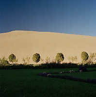 Crescent Moon lake and oasis, Singing Sand Dunes, Mingsha Mountain, Silk Route; Dunhuang, Jiuquan, Gansu Province, China.