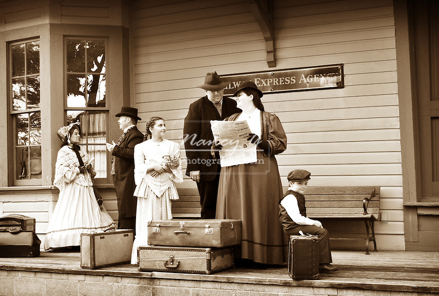 Travelers waiting for the train on a historical train depot platform