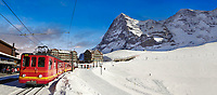 Panoramic of Jungfraujoch train at Kleiner Scheidegg in winter snow with The Eiger (left) then The Monch Mountains. Swiss Alps Switzerland