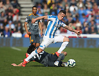 Leicester City's Shinji Okazaki is tackled by Huddersfield Town's Jonathan Hogg <br /> <br /> Photographer Stephen White/CameraSport<br /> <br /> The Premier League - Huddersfield Town v Leicester City - Saturday 6th April 2019 - John Smith's Stadium - Huddersfield<br /> <br /> World Copyright © 2019 CameraSport. All rights reserved. 43 Linden Ave. Countesthorpe. Leicester. England. LE8 5PG - Tel: +44 (0) 116 277 4147 - admin@camerasport.com - www.camerasport.com