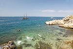 People swimming off the rocky coast at Rovinj, Istria, Croatia, Adriatic, Europe