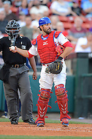 Buffalo Bisons catcher Mike Nickeas #11 throws back to the pitcher in front of umpire Kelvin Bultron during a game against the Durham Bulls on June 24, 2013 at Coca-Cola Field in Buffalo, New York.  Durham defeated Buffalo 7-1.  (Mike Janes/Four Seam Images)