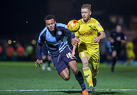 Aaron Amadi-Holloway of Wycombe Wanderers & Jordan Evans of Oxford United in action during the Sky Bet League 2 match between Wycombe Wanderers and Oxford United at Adams Park, High Wycombe, England on 19 December 2015. Photo by Andy Rowland.