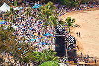 Crowds of spectators on the beach watch the 2016 Big Wave Eddie Aikau Contest, Waimea Bay, North Shore, O'ahu.