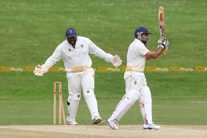 Hainault claim the third Ardleigh Green wicket - Ardleigh Green CC (batting) vs Hainault & Clayhall CC - Essex Cricket League - 28/06/14 - MANDATORY CREDIT: Gavin Ellis/TGSPHOTO - Self billing applies where appropriate - 0845 094 6026 - contact@tgsphoto.co.uk - NO UNPAID USE