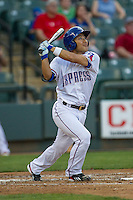 Round Rock Express designated hitter Kensuke Tanaka #8 follows through on his swing during the Pacific Coast League baseball game against the Memphis Redbirds on April 24, 2014 at the Dell Diamond in Round Rock, Texas. The Express defeated the Redbirds 6-2. (Andrew Woolley/Four Seam Images)