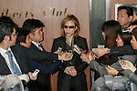 Japanese musician Yoshiki of X JAPAN answers questions from the media after attended a meeting with the members of the ruling Liberal Democratic Party of Japan (LDP) at their headquarters on November 30, 2016, Tokyo, Japan. Yoshiki was invited to help promote Prime Minister Shinzo Abe's administration project Cool Japan overseas. Cool Japan is a governmental project which aims to promote Japanese culture and attract foreign visitors. The government is targeting attracting 40 million foreign tourists per year by 2020 Olympic Games. In 2016 the number is expected to be 24 million. (Photo by Rodrigo Reyes Marin/AFLO)