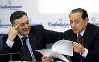 Il leader del Popolo della Liberta' Silvio Berlusconi parla accanto al presidente della Confartigianato Giorgio Guerrini durante l'incontro presso la sede dell'organizzazione a Roma, 27 marzo 2008..Leader of the People of Freedom center-right coalition Silvio Berlusconi, right, speaks during an electoral meeting organized by Confartigianato handicrafts organization in Rome, 27 march 2008. At left, Confartigianato's president Giorgio Guerrini..UPDATE IMAGES PRESS/Riccardo De Luca