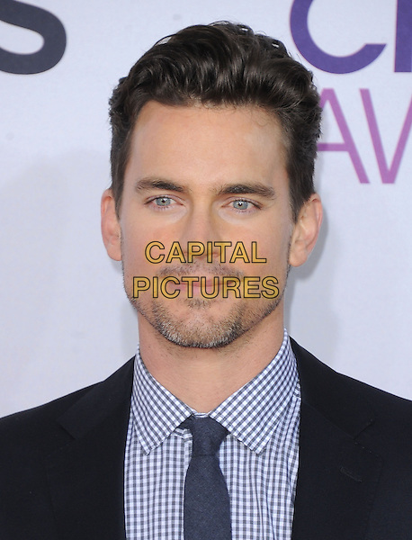 Matthew Bomer.The 2013 People's Choice Awards held at Nokia Live in Los Angeles, California 9th January 2013                                                                   .headshot portrait black blue white check shirt stubble facial hair .CAP/DVS.©DVS/Capital Pictures.