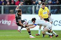 Anthony Watson of Bath Rugby is tackled in possession. European Rugby Challenge Cup match, between Bath Rugby and Pau (Section Paloise) on January 21, 2017 at the Recreation Ground in Bath, England. Photo by: Patrick Khachfe / Onside Images
