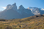 Hikers Enjoying Trail below Mountain Peaks of Torres del Paine National Park in Patagonia Chile