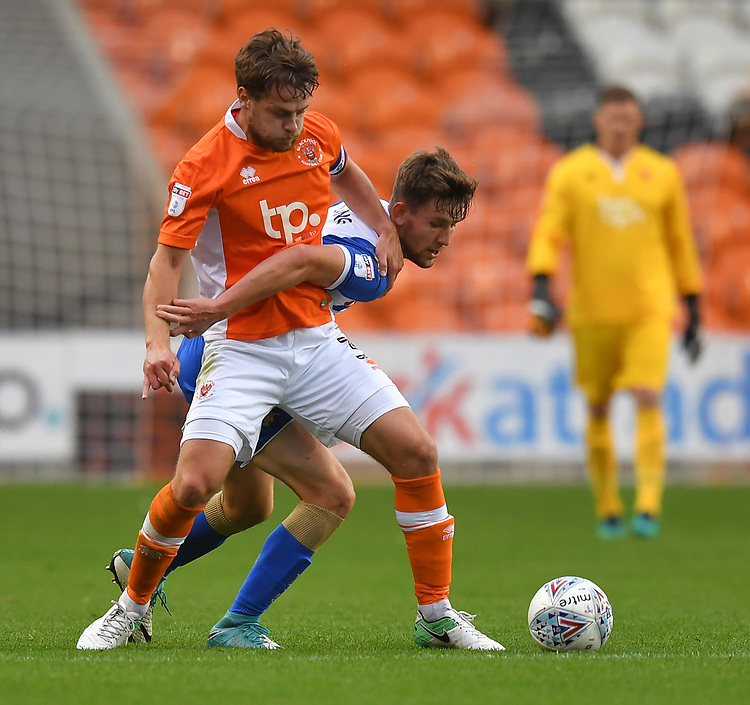 Blackpool's Andy Taylor battles with Wigan Athletic's Callum Lang<br /> <br /> Photographer Dave Howarth/CameraSport<br /> <br /> The EFL Checkatrade Trophy - Blackpool v Wigan Athletic - Tuesday 29th August 2017 - Bloomfield Road - Blackpool<br />  <br /> World Copyright &copy; 2018 CameraSport. All rights reserved. 43 Linden Ave. Countesthorpe. Leicester. England. LE8 5PG - Tel: +44 (0) 116 277 4147 - admin@camerasport.com - www.camerasport.com