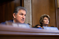 United States Senator Lisa Murkowski (Republican of Alaska) listens as United States Senator Joe Manchin III (Democrat of West Virginia) speaks during the U.S. Senate Committee on Energy and Natural Resources hearing considering the nomination of Dan Brouillette to be Secretary of Energy on Capitol Hill in Washington D.C., U.S., on Thursday, November 14, 2019.  <br /> <br /> Credit: Stefani Reynolds / CNP/AdMedia