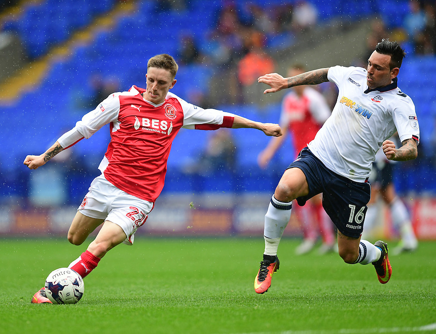Fleetwood Town's Ashley Hunter gets a shot in on goal under pressure from Bolton Wanderers's Mark Davies<br /> <br /> Photographer Chris Vaughan/CameraSport<br /> <br /> Football - The EFL Sky Bet League One - Bolton Wanderers v Fleetwood Town - Saturday 20 August 2016 - Macron Stadium - Bolton<br /> <br /> World Copyright &copy; 2016 CameraSport. All rights reserved. 43 Linden Ave. Countesthorpe. Leicester. England. LE8 5PG - Tel: +44 (0) 116 277 4147 - admin@camerasport.com - www.camerasport.com