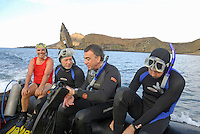 Group of scuba divers after a dive on boat, Bartolome Island, Ecuador, Galapagos Archipelago