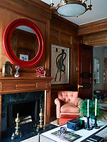 Wood panelling on the walls and fire surround gives the study a warm feel.