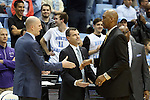 20 January 2016: Wake Forest head coach Danny Manning (right) shakes hands with UNC assistants Brad Frederick (left) and C.B. McGrath (center). The University of North Carolina Tar Heels hosted the Wake Forest University Demon Deacons at the Dean E. Smith Center in Chapel Hill, North Carolina in a 2015-16 NCAA Division I Men's Basketball game. UNC won the game 83-68.