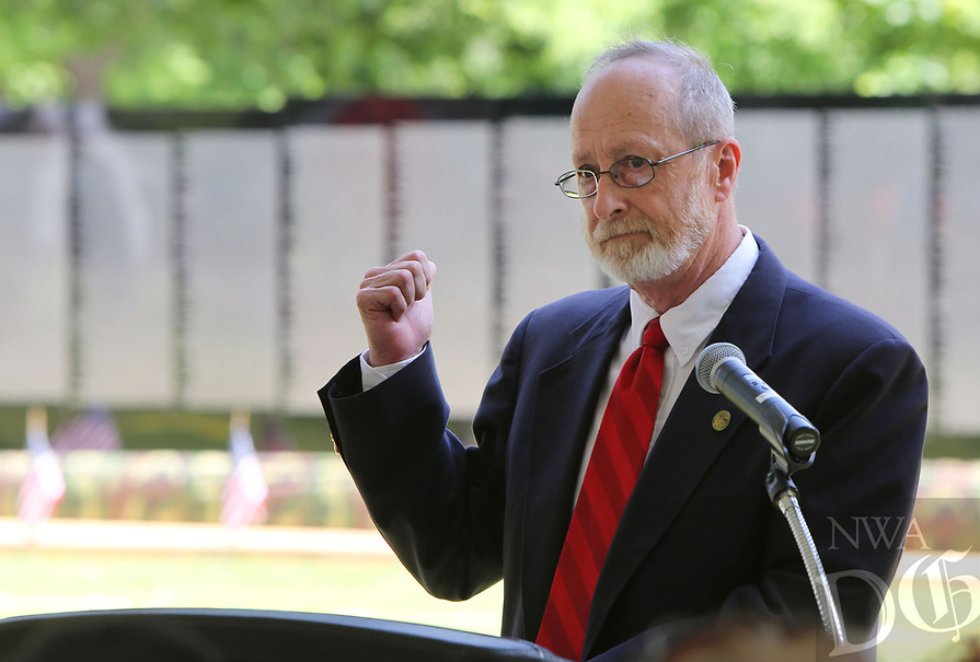 NWA Democrat-Gazette/DAVID GOTTSCHALK  Lioneld Jordan, mayor city of Fayetteville, becomes emotional as he pauses for a moment Thursday, May 18, 2017, as he gestures towards the Vietnam Veterans Memorial The Moving Wall during opening ceremonies on the campus of the Veterans Health Care System of the Ozarks in Fayetteville. The wall has been touring the country for more than 30 years and will on the camus through Monday, May 22. The Moving Wall is a half scale replica of the memorial in Washington D.C..