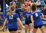 Marquette players celebrate after scoring. Jerseyville played at Alton Marquette in a girls volleyball game on Wednesday September 11, 2018.<br /> Tim Vizer/Special to STLhighschoolsports.com