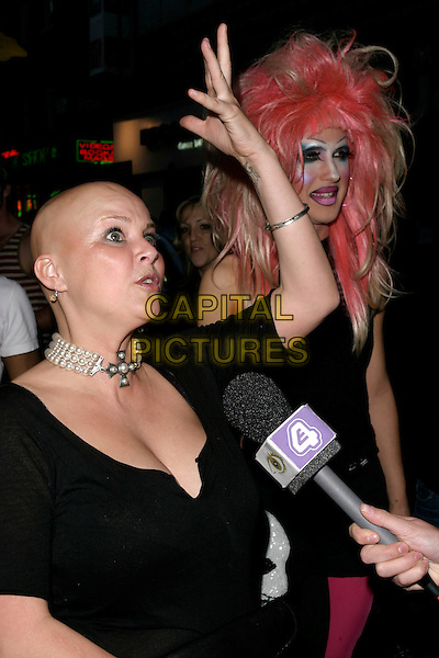 GAIL PORTER.Shadow Lounge Enchanted Party, The Shadow Lounge, London, UK..July 13th, 2006.Ref: AH.half length black pink hair cross dresser make up make-up pearl necklace choker cleavage interview hand.www.capitalpictures.com.sales@capitalpictures.com.© Capital Pictures.