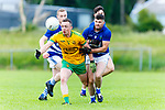 Padraig O'Connor Gneeveguilla breaks away from Shane McSweeney Laune Rangers during their Division 3 clash in Killorglin on Saturday evening