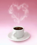 Cup of steaming aromatic black hot coffee with heart shaped steam over pink background. The steam is a realistic computer graphic effect. Valentines Day love romantic conceptual still life photo-illustration.