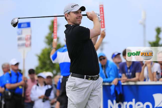 Stephen Gallacher (SCO) tees off the 1st tee to start his match during Sunday's Final Round of the 2014 Nordea Masters held at the PGA of Sweden National Lakes Course, Malmo, Sweden.1st June 2014.<br /> Picture: Eoin Clarke www.golffile.ie