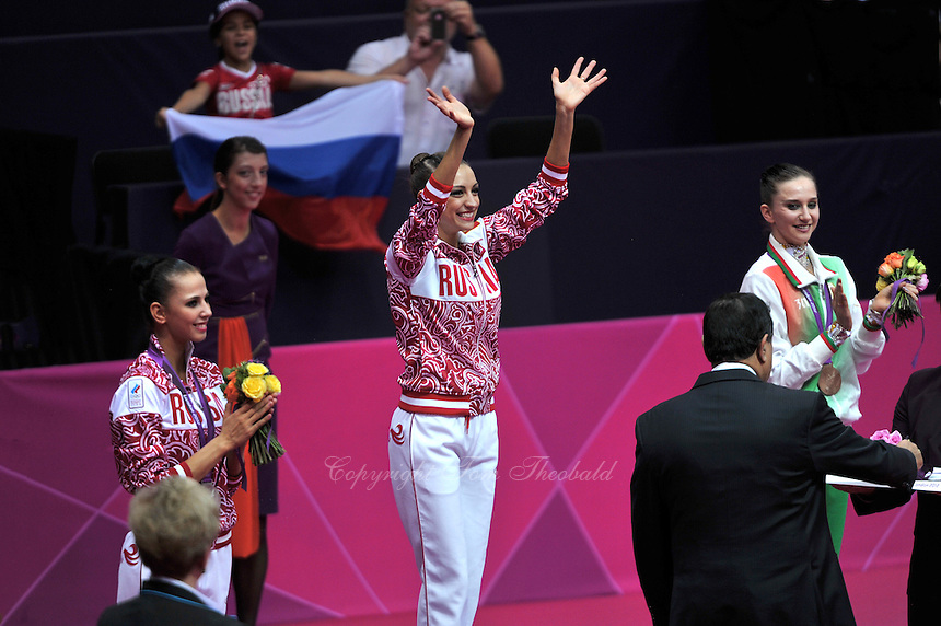 August 11, 2012; London, Great Britain;  (L-R) DARIA DMITRIEVA of Russia (silver), EVGENIYA KANAEVA of Russia (gold) and LIUBOV CHARKASHYNA of Belarus (bronze) celebrate during medals ceremony at London 2012 Olympics.