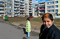 A boy poses for a picture in front of the apartment block in the Gipsy ghetto of Chanov, Most, Czech Republic, 26 March 2008.