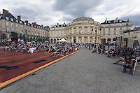 Les Tombees de la Nuit animent le centre-ville de Rennes au mois de juillet.Opera de Rennes au fond