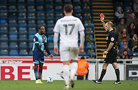 Referee Graham Horwood shows Myles Weston of Wycombe Wanderers a red card in the 90 minute during the Sky Bet League 2 match between Wycombe Wanderers and Barnet at Adams Park, High Wycombe, England on 22 October 2016. Photo by Andy Rowland.