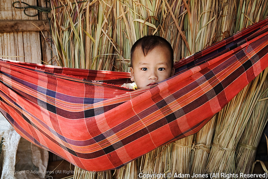 Young boy in hammock, Karen Hill Tribe in northern Thailand