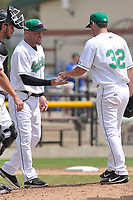 Clinton LumberKings manager Denny Hocking (11) takes the ball from departing pitcher Chris Castellanos (32) during the game against the Bowling Green Hot Rods at Ashford University Field on May 2, 2018 in Clinton, Iowa.  (Dennis Hubbard/Four Seam Images)