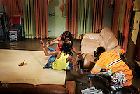 Actresses Evelyn Ali (left, above) and Ogbor Josephine Mena (left, below) fight over Prince, a businessman and Casanova, played by Emeka Ike (right), who is encouraging them on the set of a Nollywood movie production.