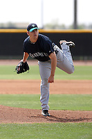 Jimmy Gilheeney #25 of the Seattle Mariners plays in a minor league spring training game against the San Diego Padres at the Padres minor league complex on March 19, 2011  in Peoria, Arizona. .Photo by:  Bill Mitchell/Four Seam Images.
