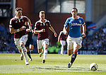 Lee Wallace drags the Hearts players to the corner flag