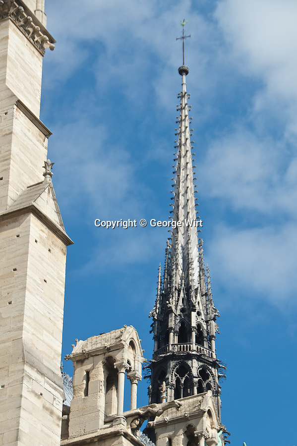 Notre-Dame de Paris, one of the world's most beloved historic sights, was extensively damaged by a fire on April 15, 2019, which destroyed its wooden roof and its spire, long a landmark on the Parisian skyline.