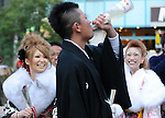 Kimono-clad 20-year-old Japanese women watch another newly anointed adult male down a bottle of wine after attending  a ceremony held for Coming-of-Age Day in Tokyo, Japan. While Japanese women can marry as early as 16 years of age and men at 18, neither is considered to reach adulthood until they reach 20, when they can also legally begin to smoke, drink and vote.ey can also legally begin to smoke, drink and vote.